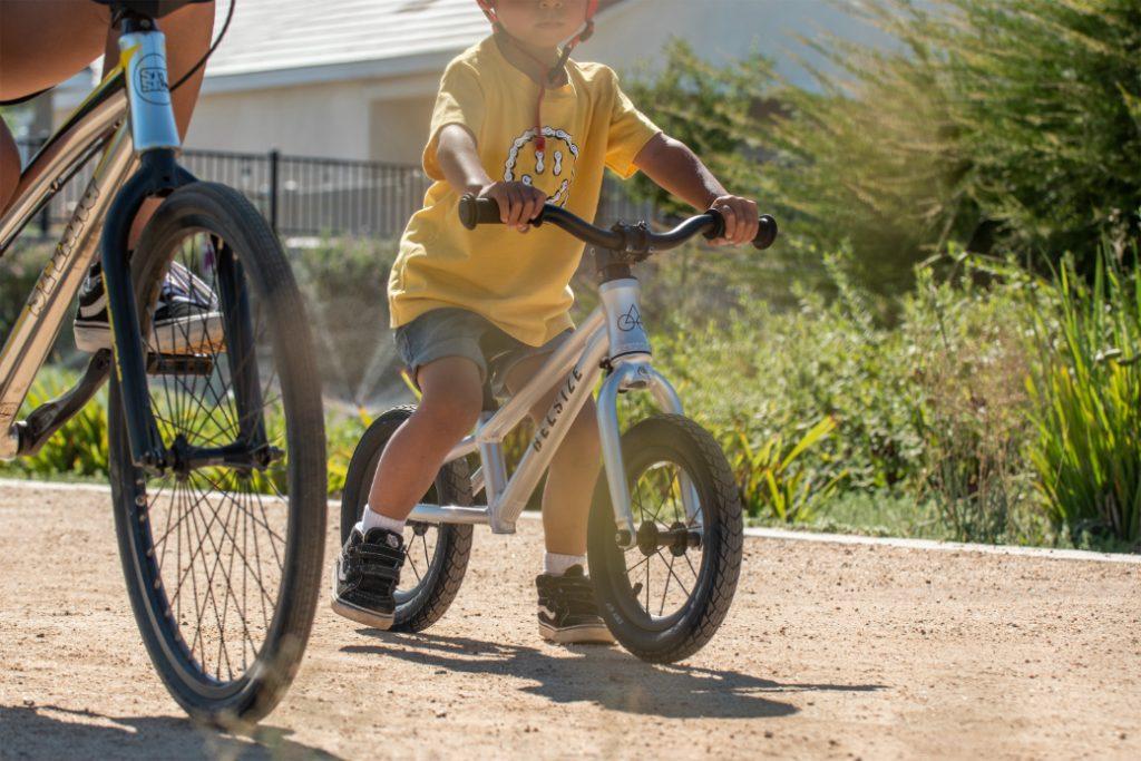 child on the belsize balance bike