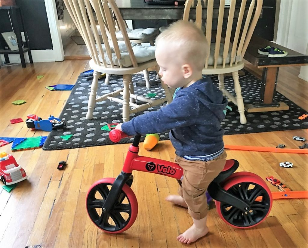 toddler on yvelo balance bike